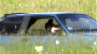 Horny couple caught fucking inside car