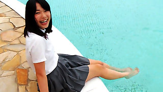 Innocent Asian schoolgirl gets wet outdoors.
