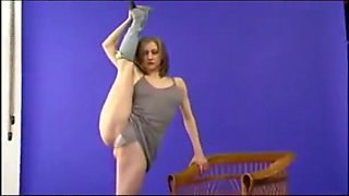 Super flexible beauty does a standing split in a dress