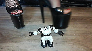 Lady L crush robot with sexy extreme high heels .