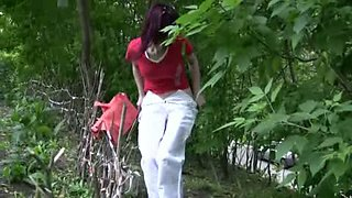 Her white pants are dripping wet from lots of piss