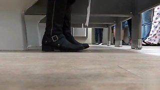 Female feet and shoes in the public toilet