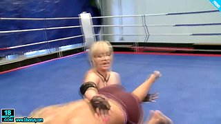 Two hot raunchy lesbian babes wrestling half naked in the ring