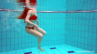 Sweet looking swimmer Katrin Bulbul is striping under the water