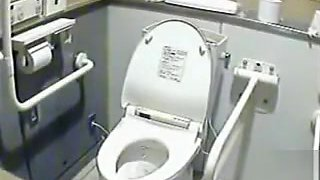 Lovely Japanese girls pee in a public toilet
