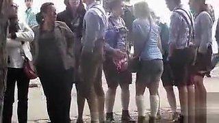 Oktoberfest girl in toilet line has to pee badly