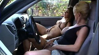 Horny big tits lesbian pussy fingered superbly in the car