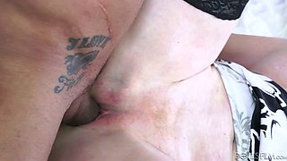 Thick and horny granny in bed spreads her legs for a younger guy