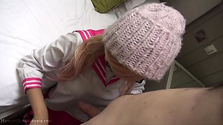 Asian schoolgirl with pink hair gives awesome blowjob
