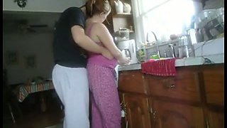 Shagging married neighbour in standing doggy position in a kitchen