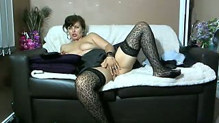 Emotional and slutty brunette lady in pantyhose and heels masturbated