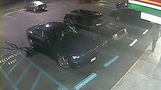 Desperate black woman soaks the parking lot next to the car