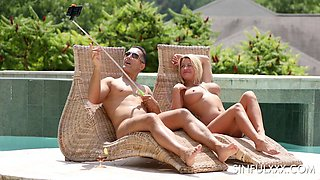 Busty MILF Sienna Day fucks her husband in a pool on a vacation
