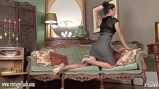 Hot brunette masturbates in leopard heels and vintage nylons