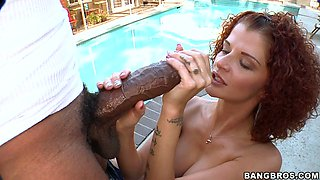 Curly babe Joslyn James enjoys sucking a monster cock outdoors