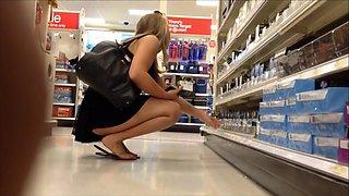 Blonde in flip flops crouches down