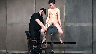 Pale leggy brunette with small tits gets her twat nailed with fuck machine