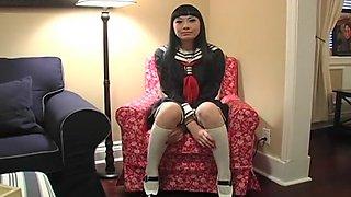Hot Asian babe in school girl costume masturbates with vibrator