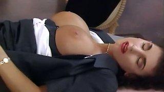 Sensational brunette busty businesswoman fucked in the office