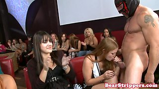 Wild party babes share masked strippers cock