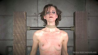 Brunette slave girl Hazel Hypnotic is examined by her mistress