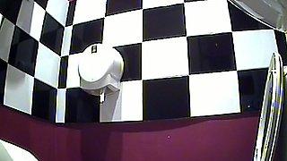 Lovely brunette stranger girl bends over and pisses in the toilet