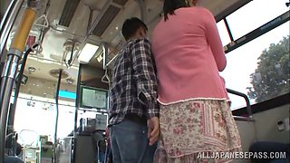 Busty Hana Haruna blows a guy in a public bus