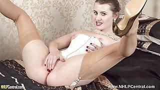 Hot Blonde fingers wanks in retro merry widow nylons heels
