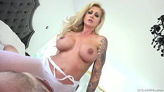 Big tittied milf Ryan Conner looks fucking hot in white fishnet body stockings