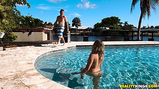 Nicolette Love seduces a lover in a pool for a nasty fuck