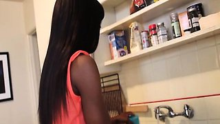 Ebony housewife jerking cock in kitchen