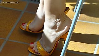 Mature feet in high heels mules