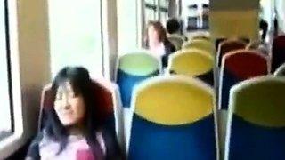 Asian milf rubs her clit on a train.