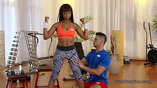 Busty black Milf fucks her coach in the gym