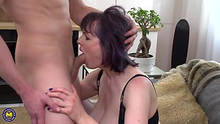 mature woman in black lingerie getting fucked from behind