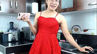 Nerdy Asian tranny in a sexy red dress flashes her nice cock