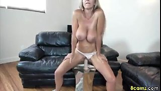 Blonde Big Boob Girl has fun on webcam riding a dildo