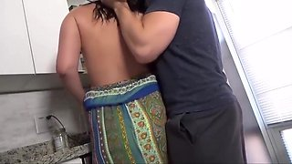 Sex in the kitchen with a milf brunette