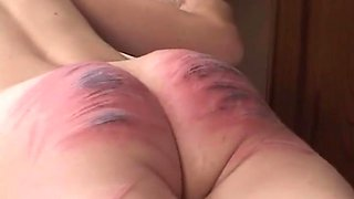 Gorgeous babe gets her firm ass hit with a stick in the kitchen