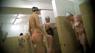 Hidden cam video of lots Russian ladies taking shower in the pool