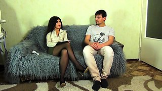 Sensual brunette in pantyhose and high heels gives a footjob