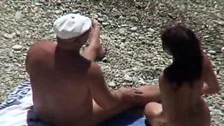 Hidden camera on a nude beach. Boss plays with pussy.