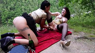 Nasty lesbian babes finger each other's holes during an outdoor fuck