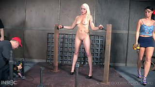 sexy bound slave is clamped and stripped