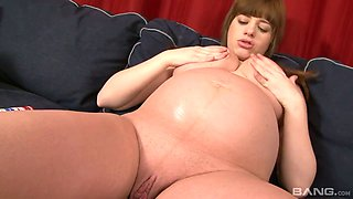 Horny pregnant bitch Laura is dildo fucking her crazy sex-hungry pussy