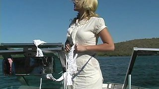 Blonde bombshell Alison Angel takes off her bikini top on a boat