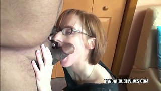 Slender nerdy redhead whore is going down on a stiff cock