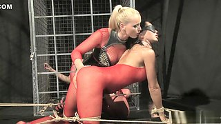 Blonde Mistress Kathia enjoys working her slave's holes with toys