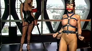 Super Hot Latex Dominatrices Humiliate a Bound Lesbian Sex Slave