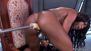 Ebony in pink dress fucking machine